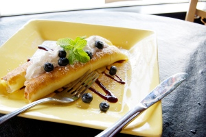 Sweet Blintz with warm ricotta filling and local aronia berry purée is served at Tally's.