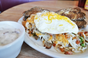 "The Cozy Café calls this dish ""The Cozy Mess."" It goes by many names depending on the restaurant. Find similar versions at Denny's, Tally's, Papa Kerns Café, Olde Main Brewing and Mullets."