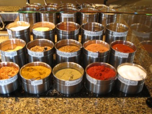 An array of spices, like these at Hu Hot, entice diners to Asian buffets.