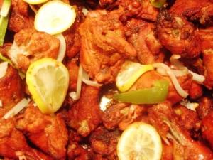 Tandoori chicken, like this from the buffet at Taj Mahal, brings an ancient dish to town.