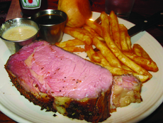 Most traditional Des Moines steakhouses specialize in slow-cooked prime rib, like this cut at Chicago Speakeasy.